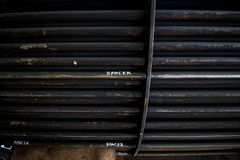 Rust steel tubes of the heat exchanger for maintenance, the water heater in the boiler as background. Manufacturing in Thailand stock photos