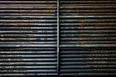 Rust steel tubes of the heat exchanger for maintenance, the water heater in the boiler as background. Manufacturing in Thailand royalty free stock photography