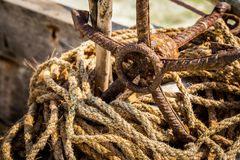 Rusted anchor with worn ropes on beach in Zanzibar royalty free stock photography