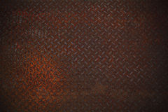 Rust texture on diamone plate Royalty Free Stock Images
