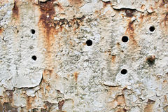 Rust textured background with holes and white paint Royalty Free Stock Photography