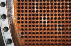 Rust tube sheet of the heat exchanger for maintenance, the water heater in the boiler as background. Manufacturing in Thailand royalty free stock image