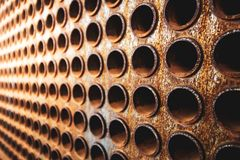 Rust tube sheet of the heat exchanger for maintenance, the water heater in the boiler as background wirh light. Manufacturing in Thailand stock images