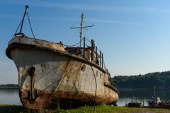 Rust tugboat on the beach. With anchor Royalty Free Stock Photo