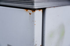 The rust on an white old refrigerator royalty free stock image