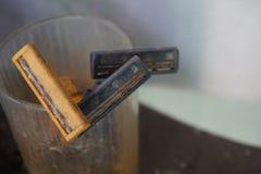 Rust Yellow and Black used plastic shavers razor stock photography