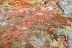 RUST AND YELLOW DISCOLOURATION ON ROCK. View of a rust, yellow and white coloured rock Royalty Free Stock Photos