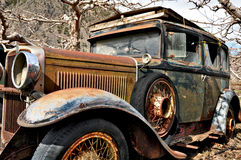 Rusted abandoned antique car stock photo