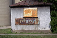 Old Rusted Agriculture Feed Signs. Old Ful-O-Pep and Pratts Feed signs on the side of a shack in Ladd, Illinois Stock Photos