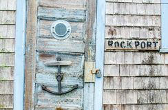 Free Rusted Anchor Door Knocker And Porthole On A Crooked Wooden Door Stock Photography - 125035962
