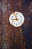 Rusted ancient clock face on tin background Stock Image