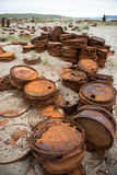Rusted barrels on the shore. Rusted barrels on the shore, Chukotka, Russia Royalty Free Stock Image