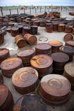 Rusted barrels on the shore. Rusted barrels on the shore, Chukotka, Russia Stock Image