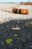 Rusted barrels on the shore, Chukotka. Rusted barrels on the shore, Chukotka, Russia Royalty Free Stock Photography