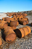 Rusted barrels on the shore, White Sea, Russia. Rusted barrels on the shore of the White Sea in. Violation of the ecology Royalty Free Stock Images