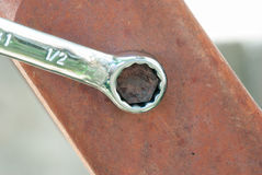 Rusted Bolt with chrome wrench Stock Photos