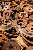 Rusted Brake Rotors. A large pile of rusty automobile disc brake rotors at a salvage yard Stock Images