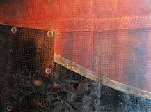 Rusted brannte die roten und schwarzen Stahlplatten auf einem benutzten soyuz Lizenzfreie Stockfotografie