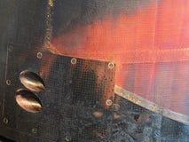 Rusted brannte rote und schwarze Metallstahlplatten Lizenzfreie Stockfotografie