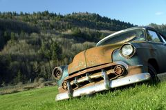 Rusted Car. 53 chevrolet left to rust in a farmers field Stock Photos