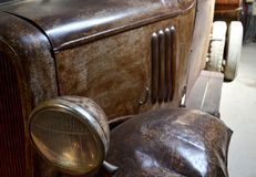 Old vintage car in workshop royalty free stock photography