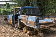 Rusted car wreck in a Hill Tribe Village. Old rusted car wreck in a Hill Tribes village, Province Chiang Rai, Northern Thailand, Thailand, Asia stock photography