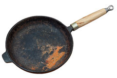 Rusted cast iron pan. With wooden grip isolated on white background Royalty Free Stock Photos