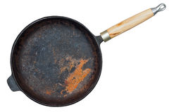 Rusted cast iron pan. With wooden grip isolated on white background Stock Photography