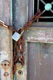 Rusted Chain on Old Bronze Door Stock Photos