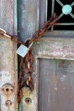 Rusted Chain on Old Bronze Door Stock Photos