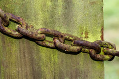 Rusted chain on an old gate post Royalty Free Stock Images