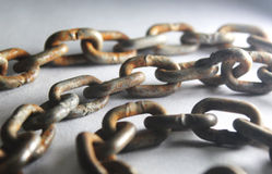 Rusted chain. A single rusty chain with on isolated white background Stock Image