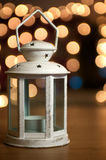 Rusted Christmas Lantern. With Sparkly Fairy lights in the background Royalty Free Stock Photos