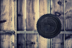 Rusted Circular Saw Blades on a Wooden Wall - Retro Royalty Free Stock Photo