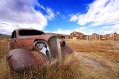 Rusted Classic Auto and Ghost Town. In Bodie State Historic Park Royalty Free Stock Photos