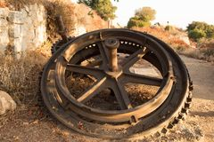 Rusted cog on the trail. A rusted cog lays discarded in the middle of the hiking trail stock photography