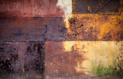 Rusted colorful metal wall detailed grunge texture Royalty Free Stock Photos