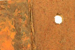 Rusted & Corroded Metal. Rusted and corroded metal with a hole straight through Stock Photo