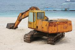 Rusted Digger on a beautiful white beach Stock Photography