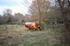 Rusted Truck Bed in a Field. A rusted, dodge, ford or Chevy truck bed sits in the pasture off a farm Royalty Free Stock Image