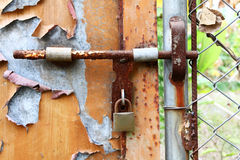 Rusted door. It is a lock with a rushed door Royalty Free Stock Photos