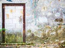 Rusted doorframe in a cobblestone wall Stock Photo