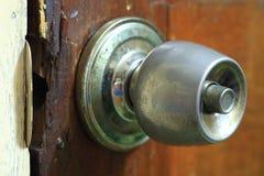 Rusted door knob. On old wooden door Stock Photos