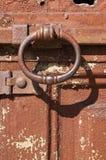 Rusted door knocker. Rusted round door knocker on wooden door stock photo