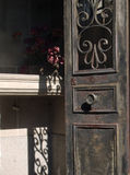 Rusted Door to Tomb with Flowers at Pere Lachaise Cemetery Franc Royalty Free Stock Images