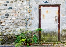 Rusted doorframe in a cobblestone wall Royalty Free Stock Photo