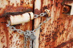 Rusted doors chained and padlocked. Old rusted doors chained and padlocked close Stock Photo