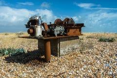 Rusted engine on pebbles beach Stock Photos