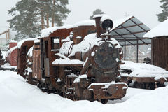 The rusted engine in the winter. In the afternoon Stock Photos