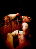 Rusted Faith. Hands with a crucifix and thorns with rust overlay Stock Image